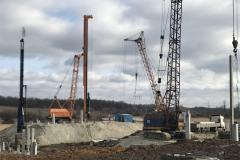 Unloading of reinforced concrete piles with an MKG-25br crane. Site: A transshipment terminal with the shipment of grain and oil crops to the river transport TOV (limited liability company) JV NIBULON. Ternivka village. Zaporizhia region Customer: TOV (limited liability company)JV NIBULON.